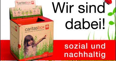 CaritasBox für gebrauchte Druckerpatronen und Handys in der Bücherei